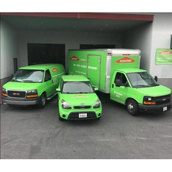SERVPRO vehicles in front of SERVPRO building