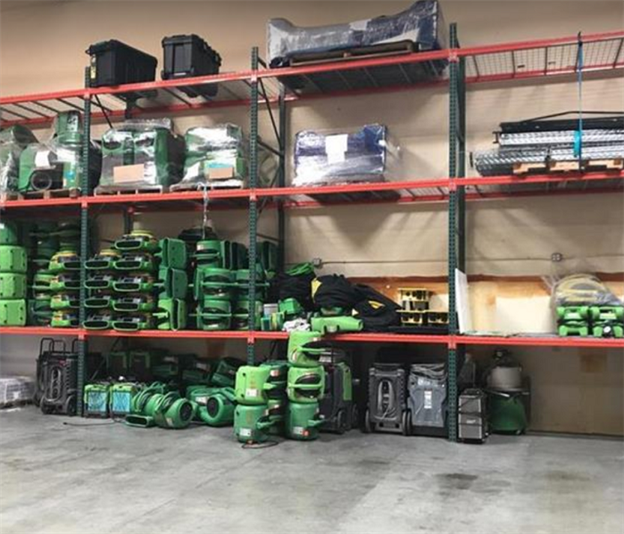 SERVPRO restoration equipment stacked inside warehouse